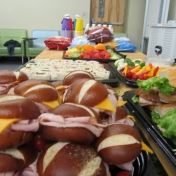 An assortment of sandwiches and finger foods were provided to the audience.