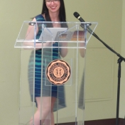Darian Bianco, English Department social media manager, reads at the mic
